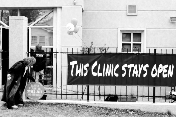 Diane Derzis, the owner of Mississippi's only remaining abortion clinic--the Jackson Women's Health Organization--places a sign outside the clinic on the occasion of the 40th anniversary of Roe v. Wade, January 22, 2013.